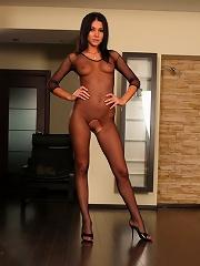 Mistress in black fishnet bodystocking lets her slave savor her sweet toes